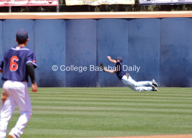 Austin Kingsolver makes a diving catch in right field.