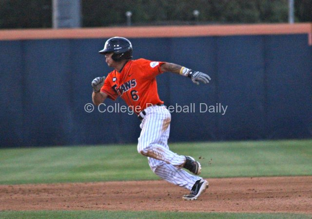 Richy Pedroza takes off for third base.