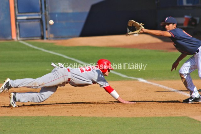 Blake Headley dives back to first.