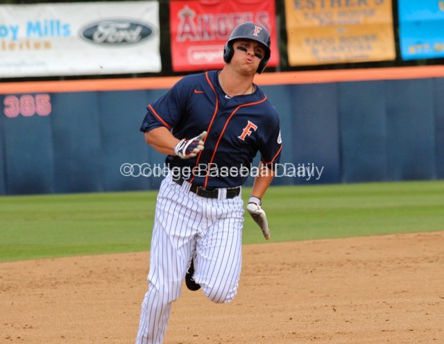 J.D. Davis chugs around third base.