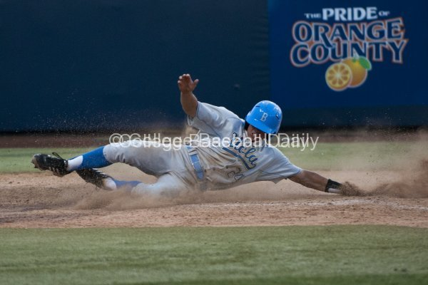 Brian Carroll slides in with the go-ahead run.