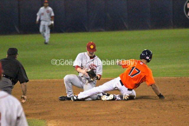 Carlos Lopez is safe as Adam Landecker can't control the ball.