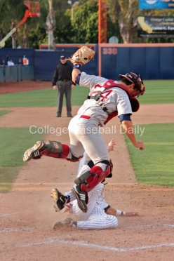 Colton Plaia jumps to avoid a sliding Michael Lorenzen
