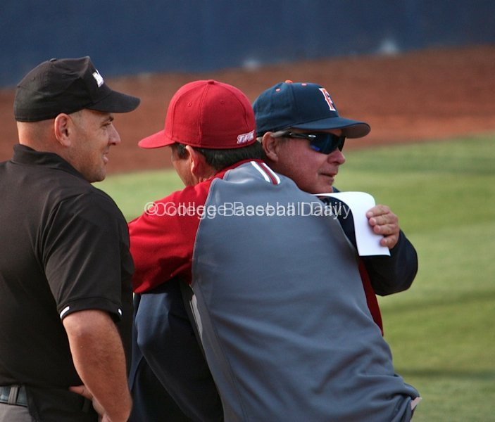 Rich Vanderhook and Jason Gill embrace before the game.