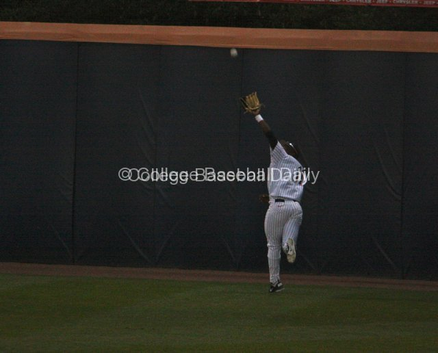 Ivory Thomas makes a running catch on the warning track.