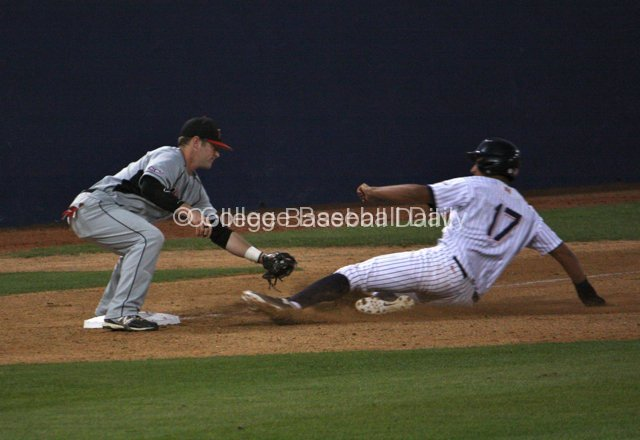 Brett Balkan applies the tag to Carlos Lopez.