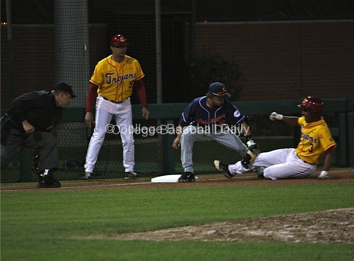 Richy Pedroza tries to tag Dante Flores.