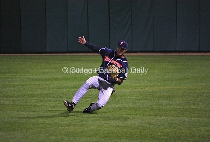 Greg Velazquez makes a sliding catch in RF.