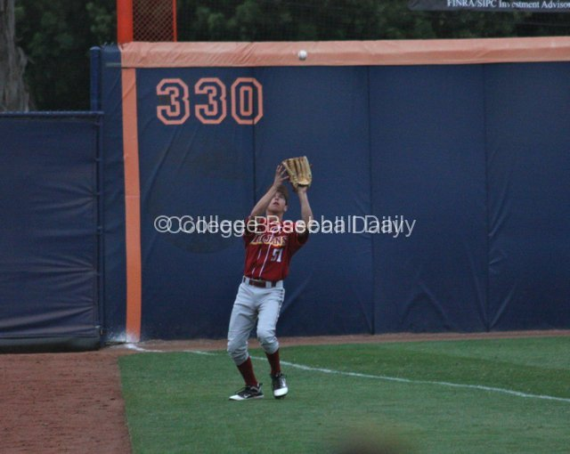 Garrett Stubbs catches a fly in foul territory.