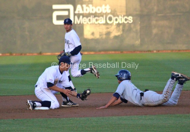 Chris Rabago applies the tag.