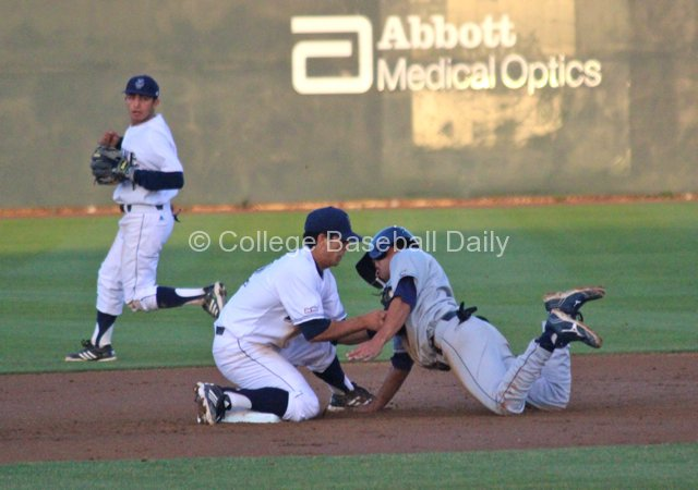 Chris Rabago tags out the Davis runner.