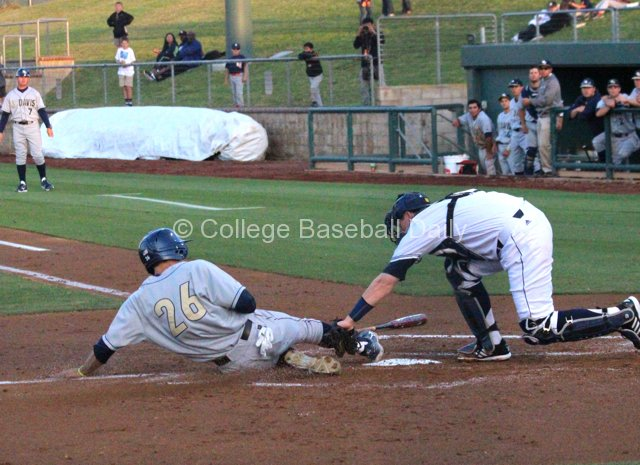 Mike Mazzara slides in under the tag.