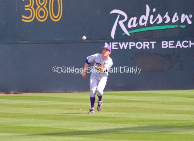 Ryan Barr lackadaisically tries to catch a fly ball.