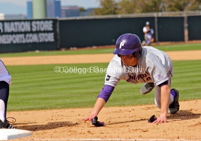 Michael Lucarelli dives back into first base.