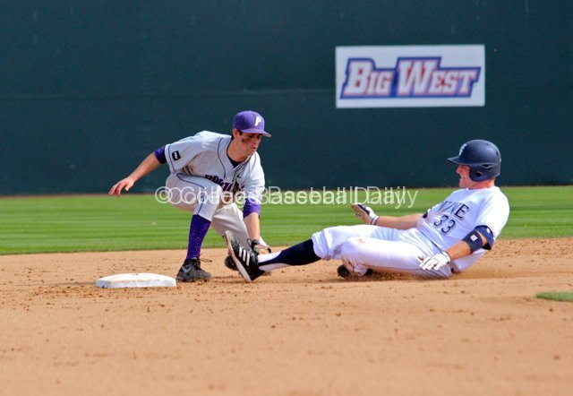 Michael Lucarelli applies the tag to Connor Spencer.