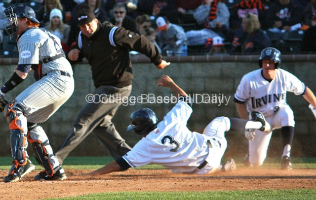 Tommy Reyes slides in safely at home.