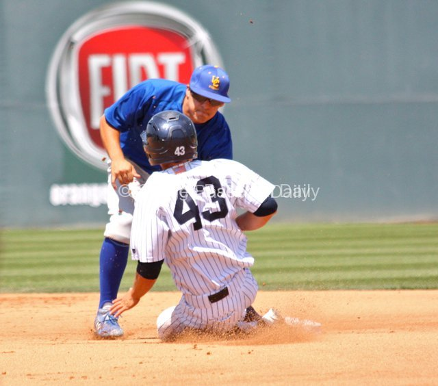 Eddie Young applies the tag to erase Jordan Fox.