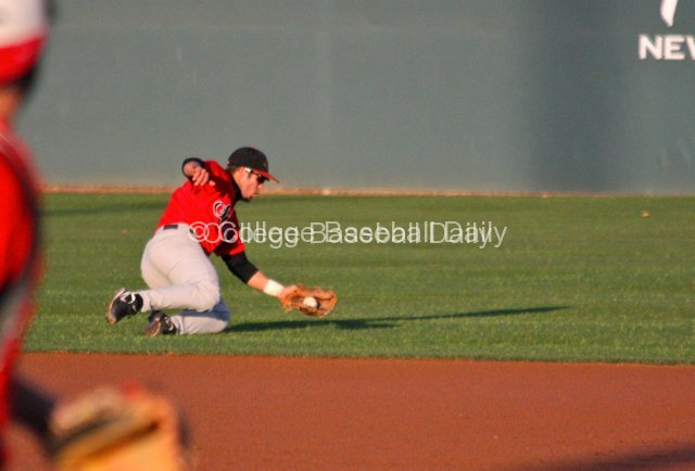 Tim Zier makes a sliding stop in short right field.
