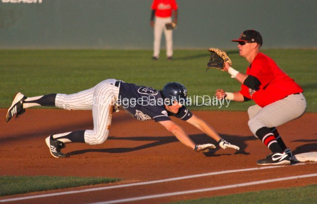 Connor Spencer dives back into first base.