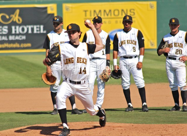 The Dirtbags look on as Landon Hunt warms up.