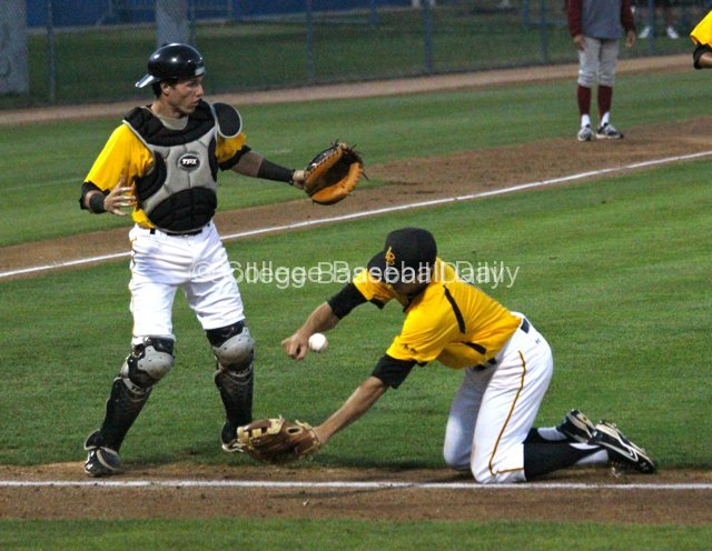 Jeff Yamaguchi falls down trying to field a bunt.