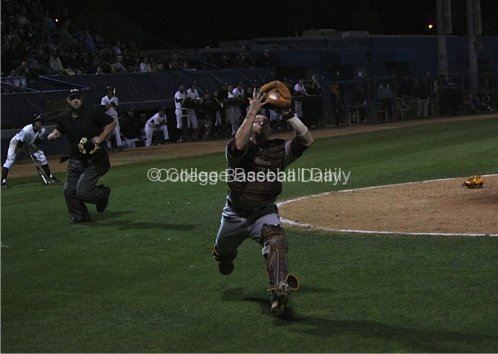 Max Rossiter catches a popped up bunt attempt.