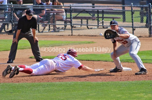 Sam Meyer catches the pickoff attempt.