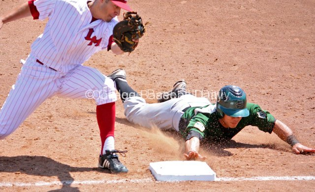 Mason Morioka dives back to first.
