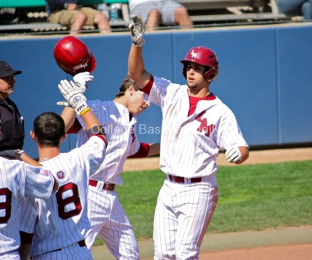 Colton Plaia is congratulated after his 2-run HR.