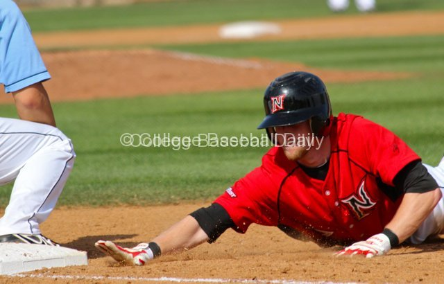Nate Ring dives back to first base.