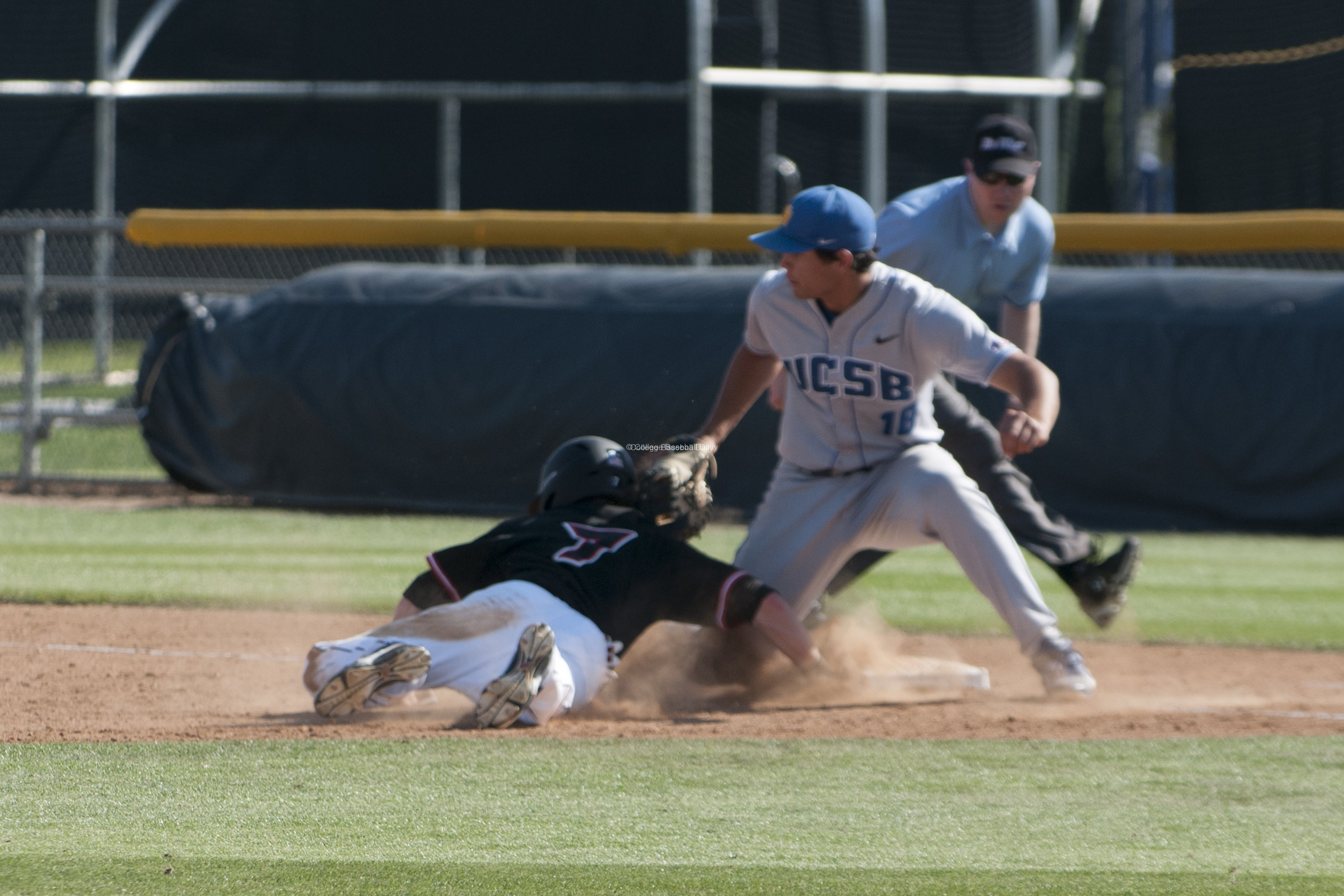 Tyler Kuresa tries to apply a tag.