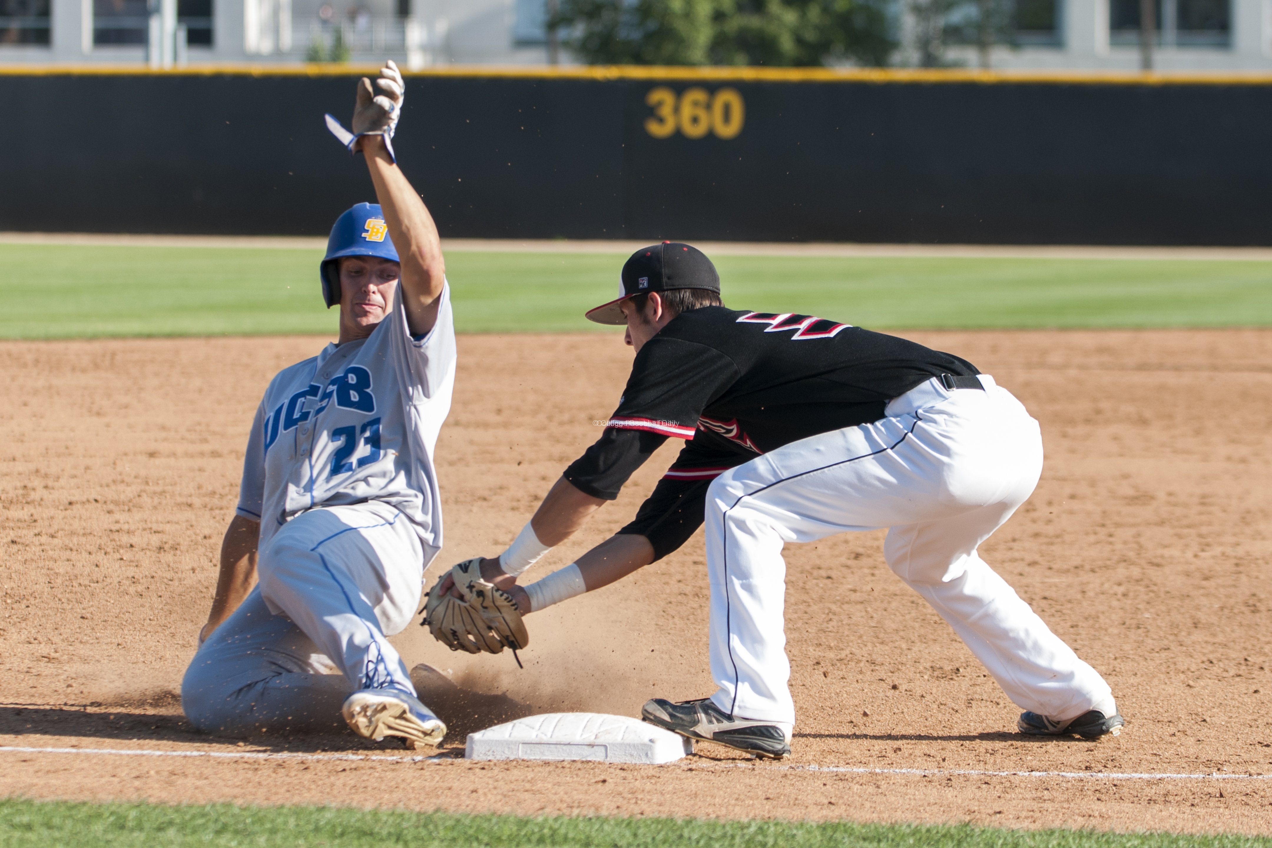 Joey Epperson is throw out at third base.