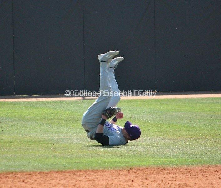 Hamilton Wise flips over after making a diving catch.