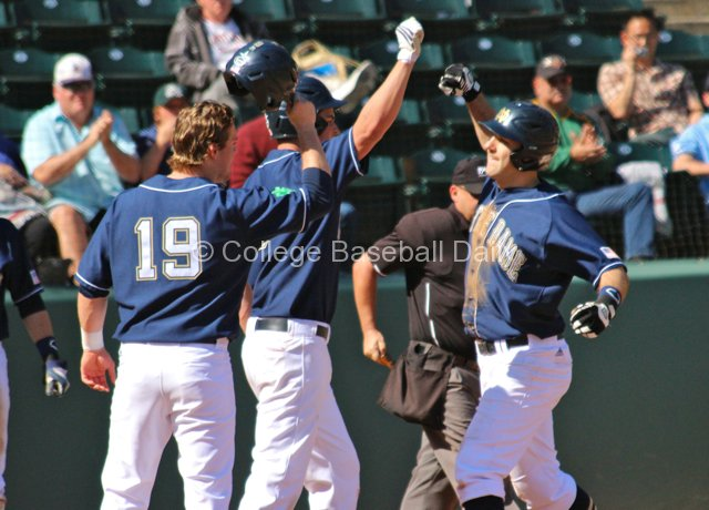 Eric Jagielo is congratulated after his home run tied the game.