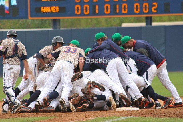 Pepperdine dogpiles Drew Hacker after his winning hit.