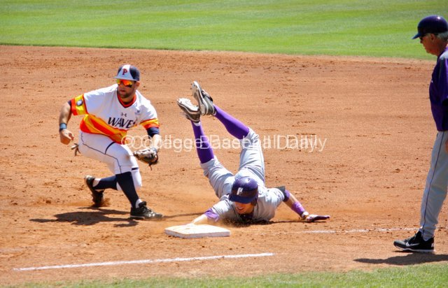 Caleb Whalen's feet fly up as he is tagged out by Joe Sever.