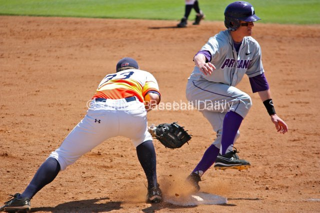 Zach McCoy avoids the tag at first base.