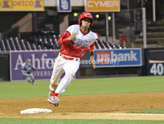 JP Crawford makes the turn around third base.