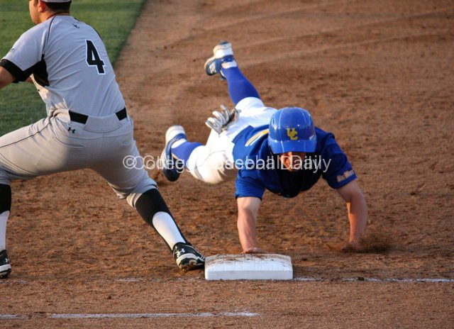Nick Vilter dives back into first base.