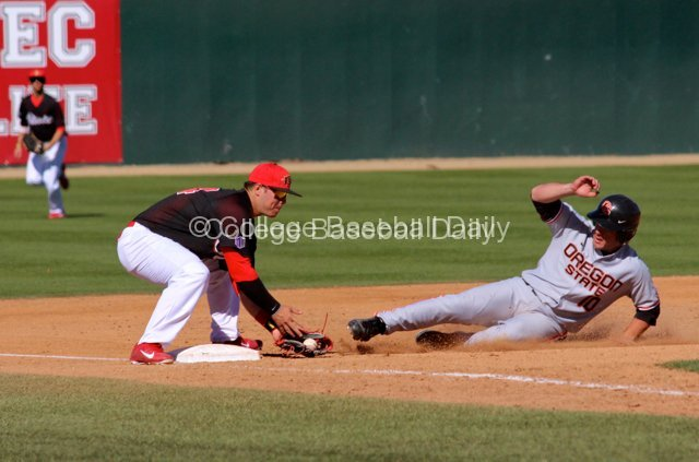 Tyler France applies the tag on Dylan Davis.