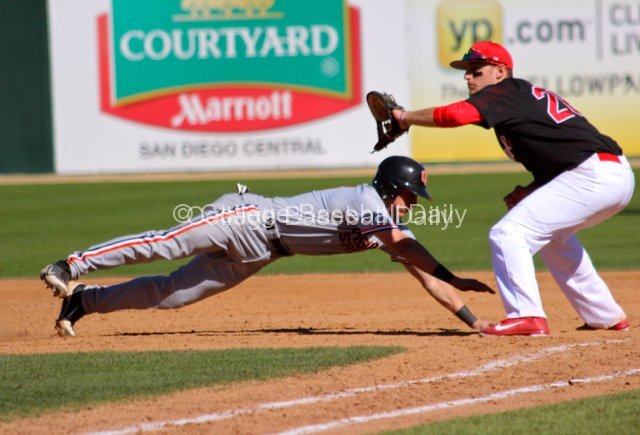 Nate Esposito dives back to first base.
