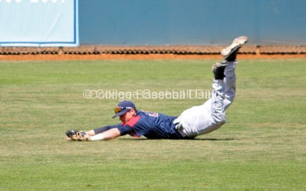 "Royce Bolinger makes a diving ""catch."""