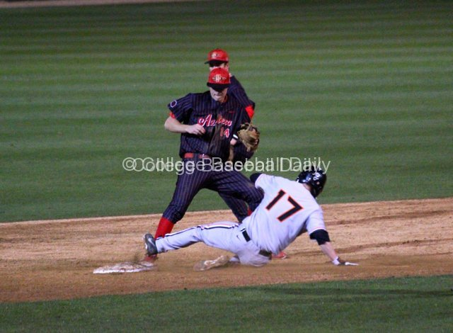 Evan Potter turns a double play himself.