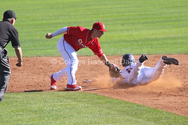 Aaron Brown gets in just under Jarred Mederos tag.