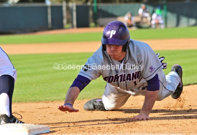 Kramer Scott dives back to first base.