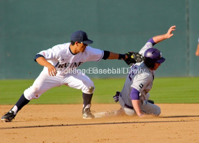 Kramer Scott tries to slide away from Chris Rabago's tag.