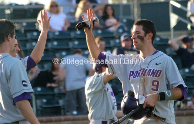 Cody Lenahan gets congratulated after scoring.