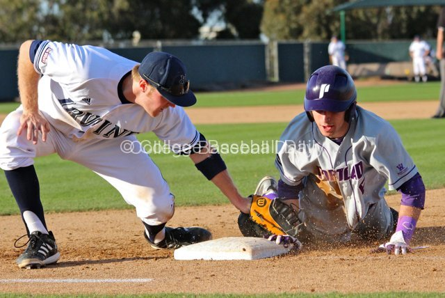 Caleb Whalen dives back before Connor Spencer can apply the tag.