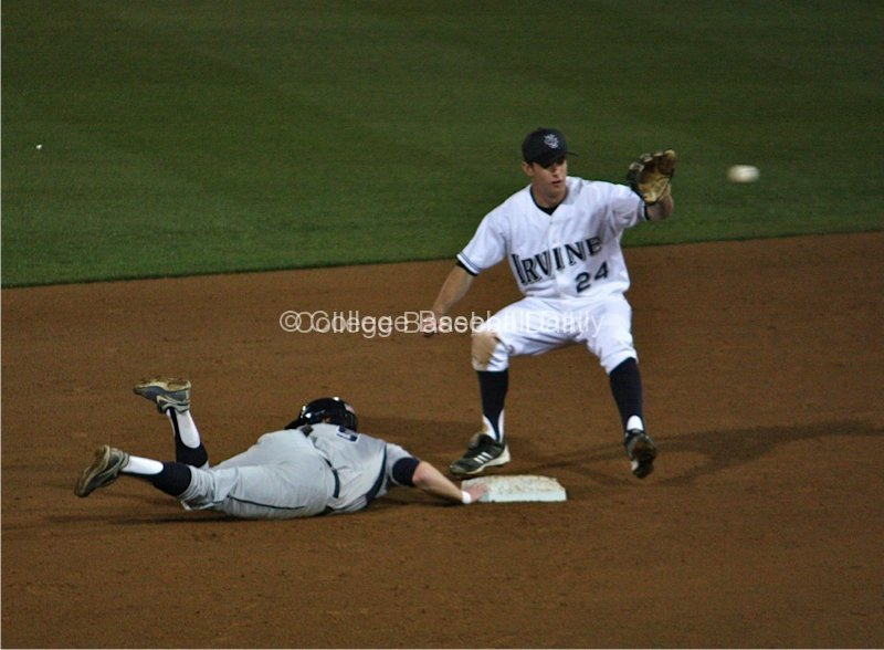 Stephen Wells dives back into second base.