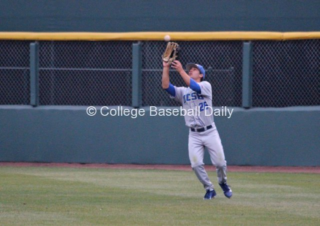 Luke Swenson pulls in a catch in right field.